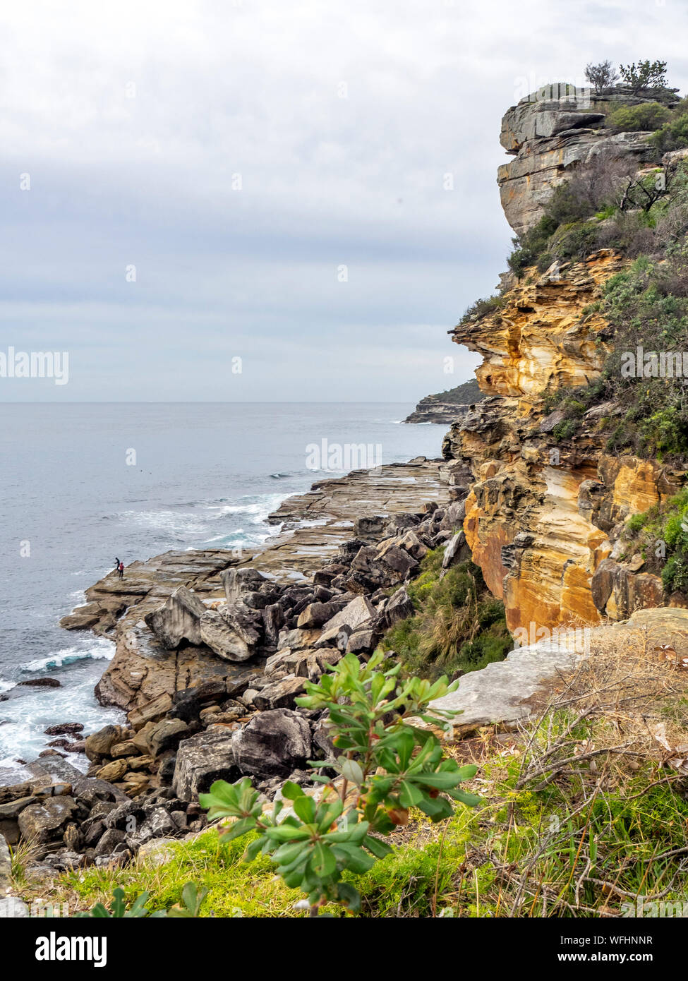 Two men rock fishing of rocks at Manly Headland Sydney NSW Australia. Stock Photo
