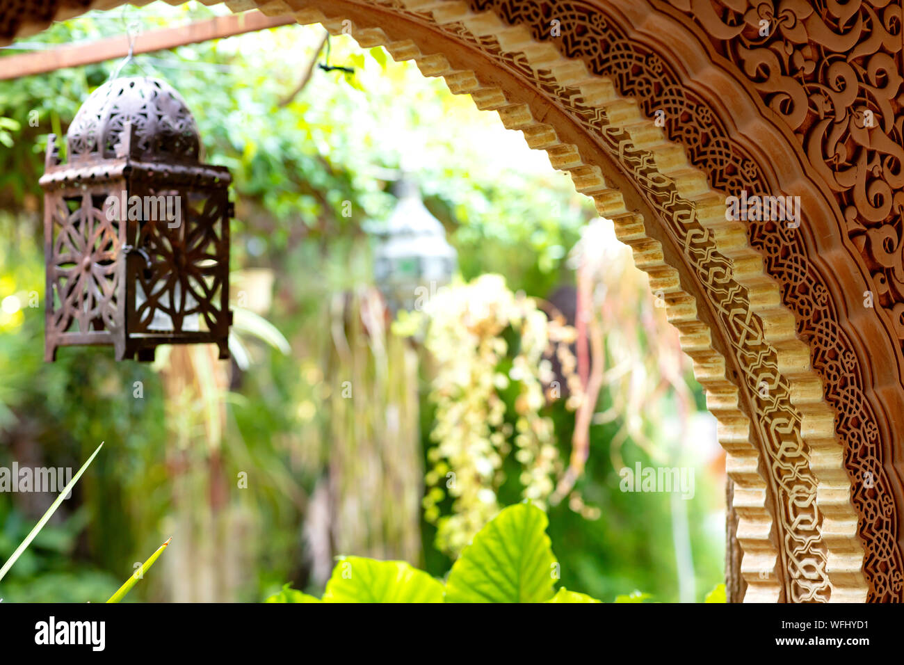 Arch Decorated With Arabic Ornaments With An Interior Green Garden