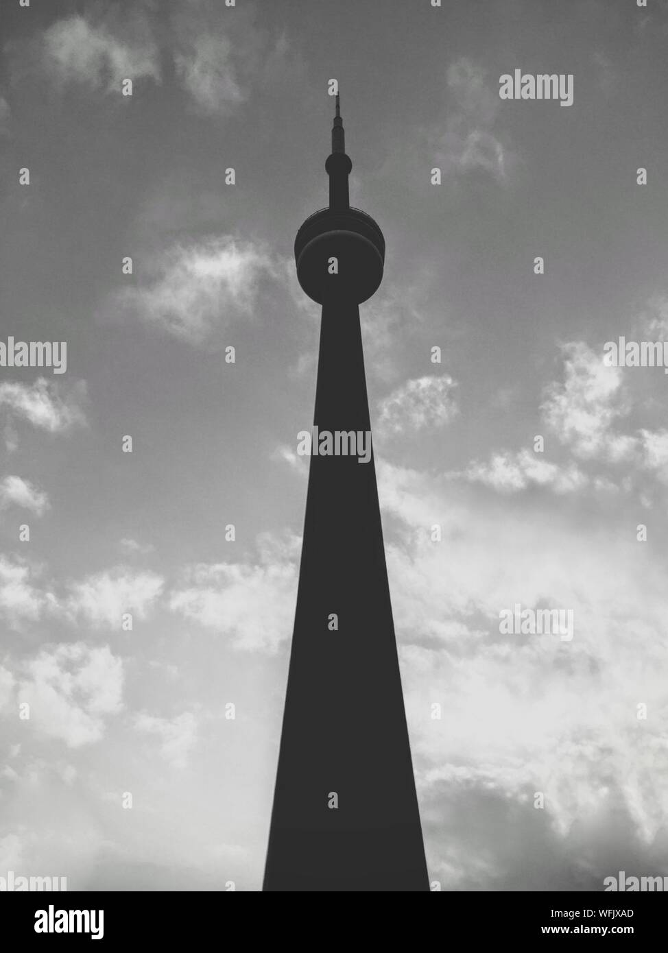 Low Angle View Of Cn Tower Against Cloudy Sky Stock Photo