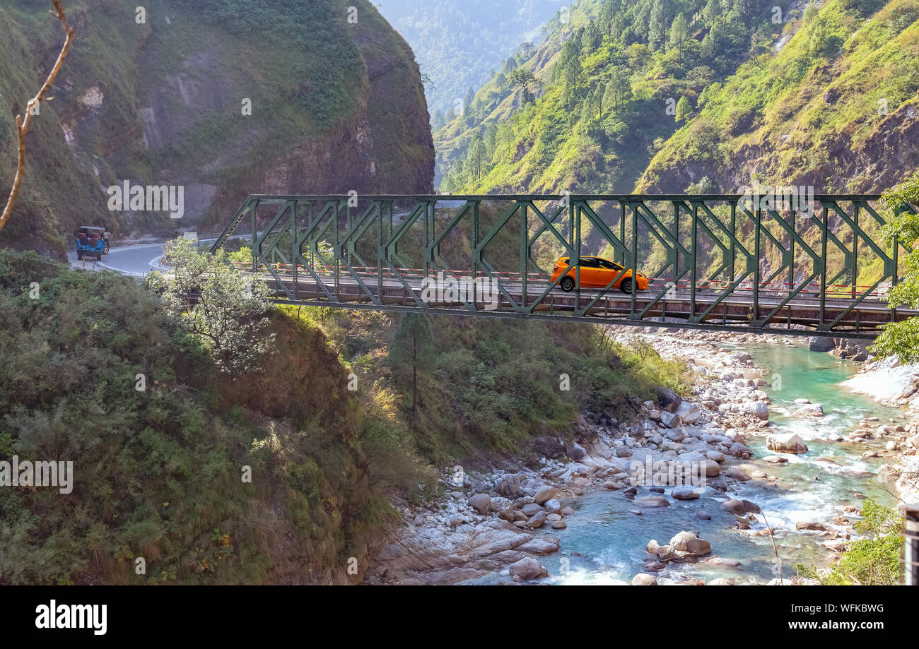 Aerial view of mountain river valley with suspension bridge and mountain range at Uttarakhand India. Stock Photo