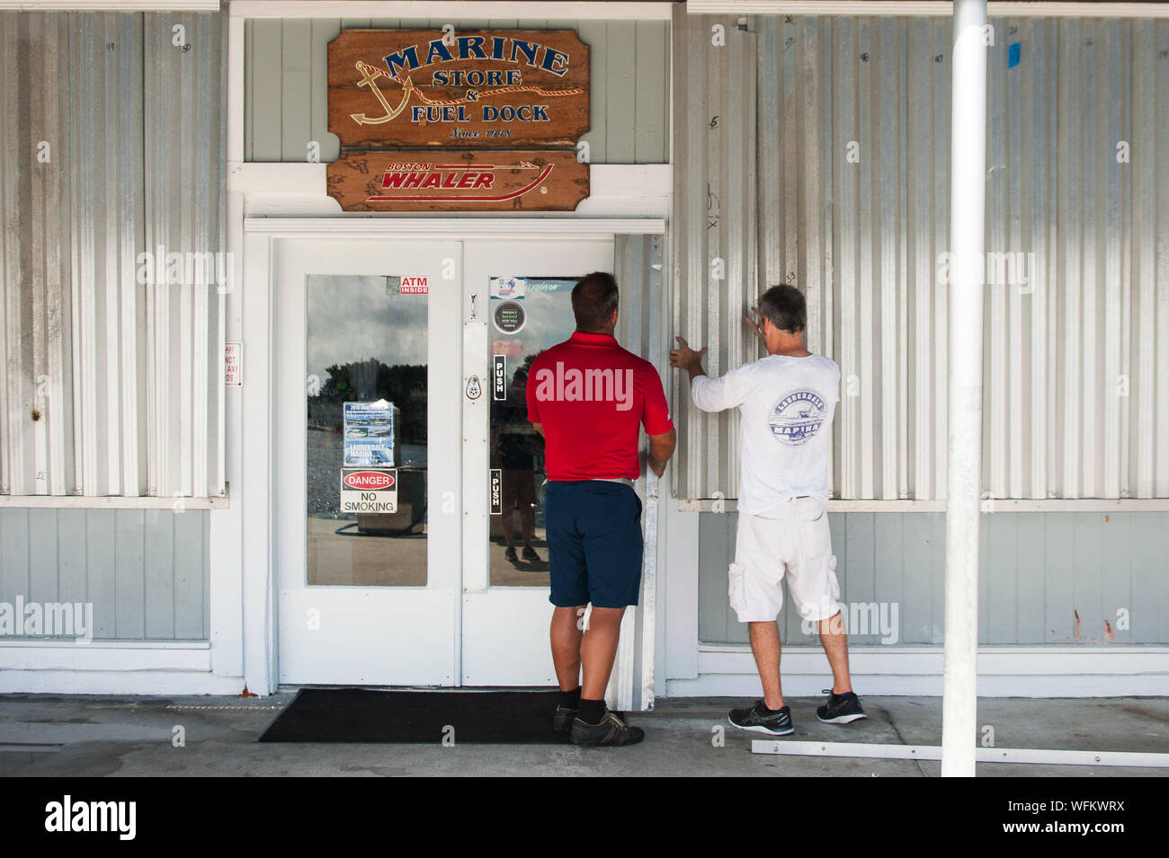 Fort Lauderdale, Florida, USA. 31st Aug, 2019. Marina workers install hurricane shutters at Fort Lauderdale Marina in enticipation of Hurricane Dorian. Credit: Orit Ben-Ezzer/ZUMA Wire/Alamy Live News Stock Photo