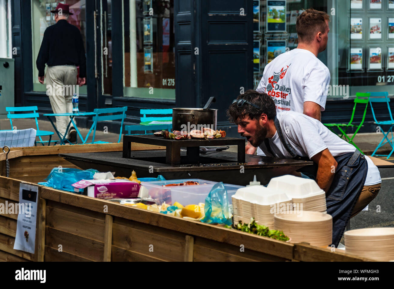 Chef Cook Lighting Up Street Charcoal Grill With Lobster And Other Seafood On It Dalkey Dublin Ireland 25 August 2019 Seafood Dalkey Lobster Fest Stock Photo Alamy