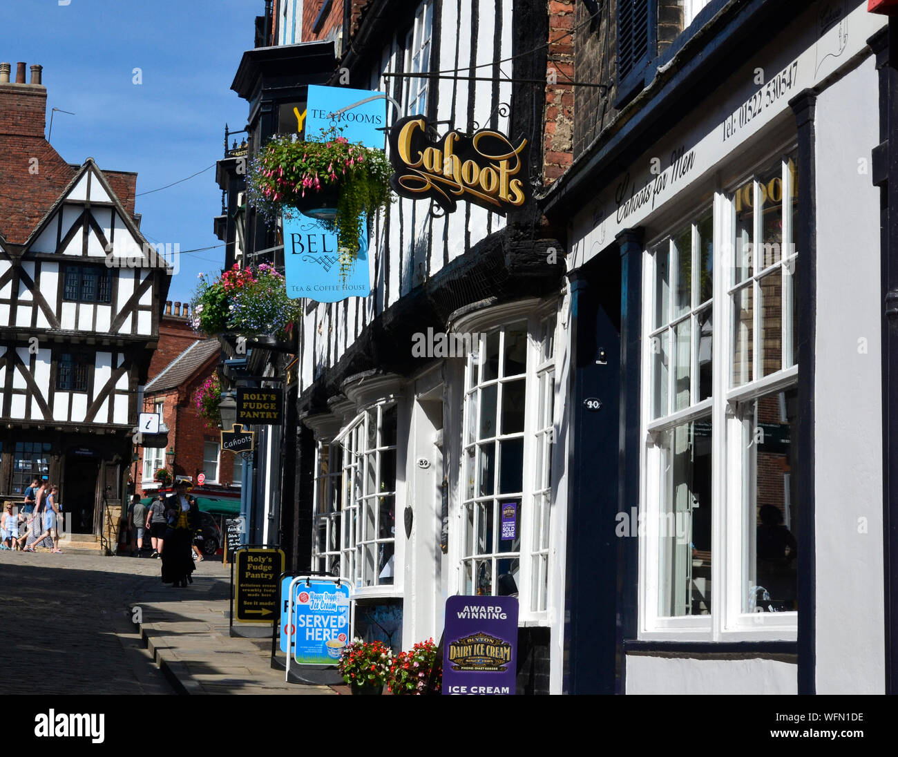Street scene on Steep Hill, Lincoln, Lincolnshire, UK. City centre. Stock Photo