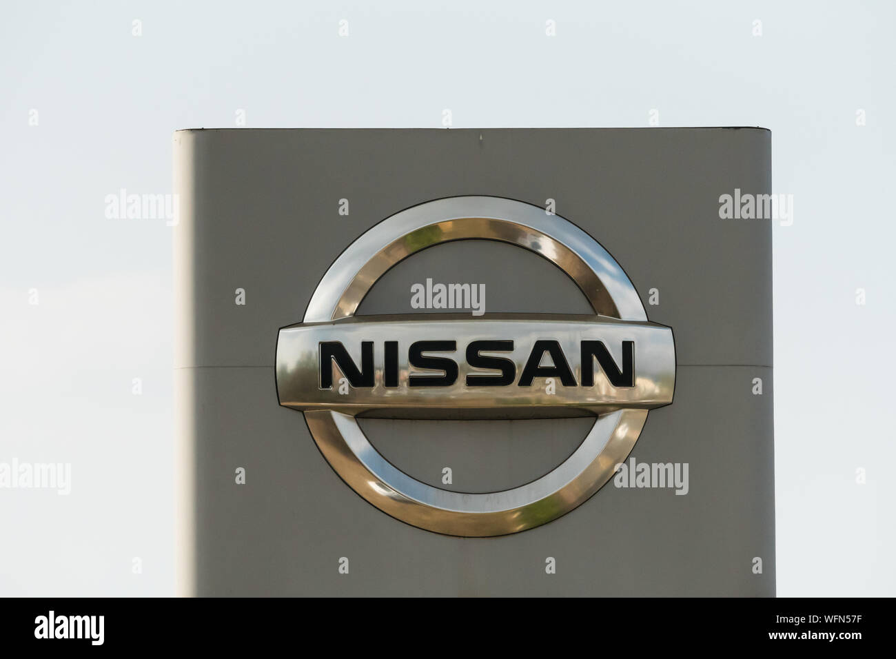 Nissan automobile manufacturer sign board with logo against a blue sky in Johannesburg, Gauteng, South Africa Stock Photo