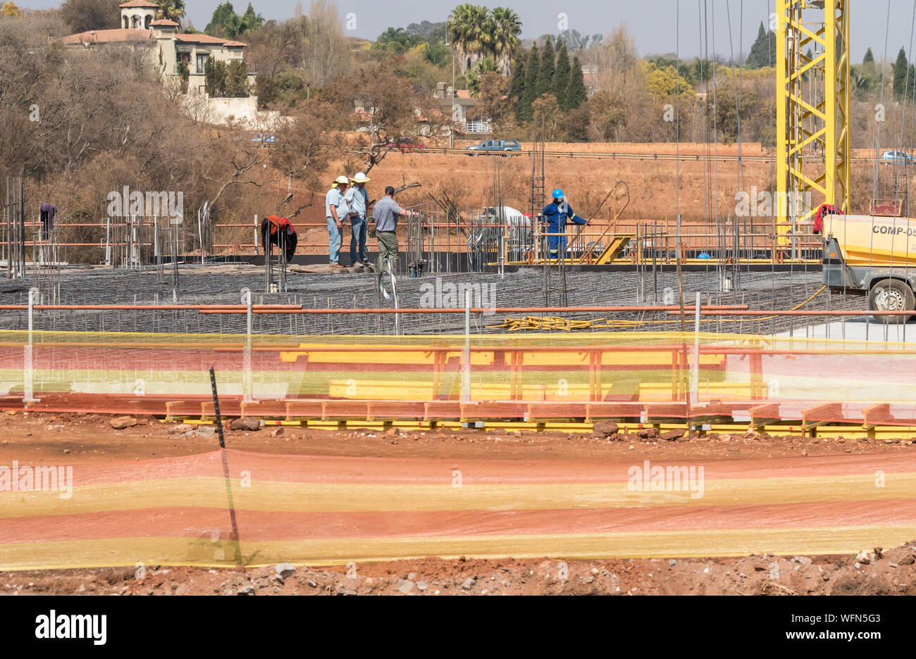 construction workers and engineers on a construction or building work site in Johannesburg, Gauteng, South Africa concept  property development Africa Stock Photo