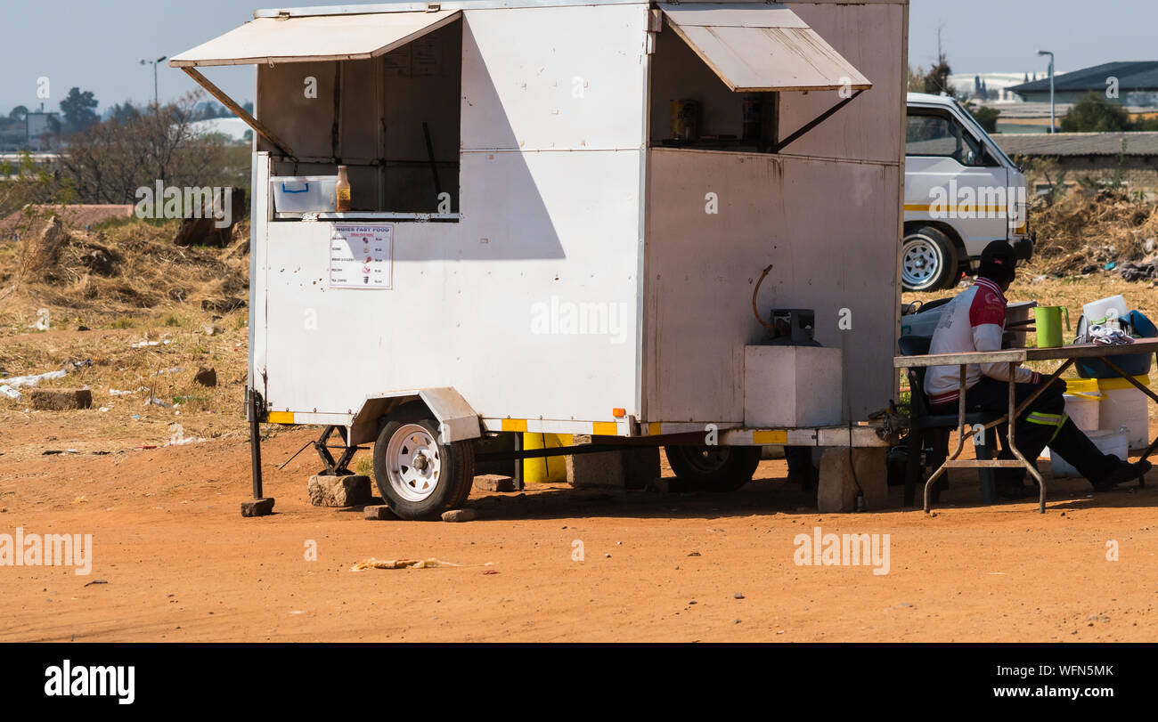 street vendor on the side of the road with a mobile kiosk or food stall selling traditional South African breakfast items in Johannesburg, Gauteng Stock Photo