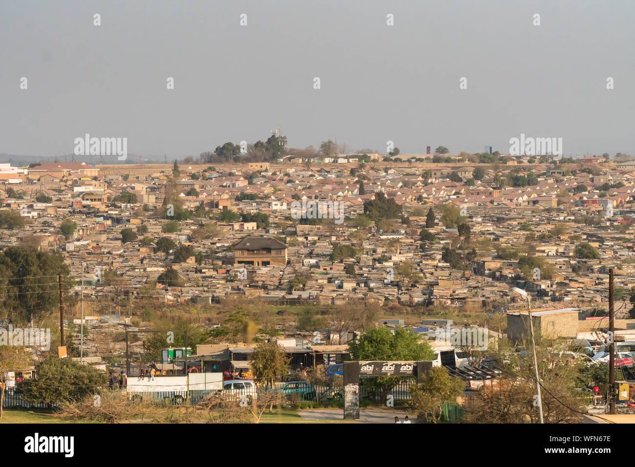 aerial view or view from above over an African township or suburb houses called Diepsloot in Johannesburg, Gauteng, South Africa on a Winter day Stock Photo