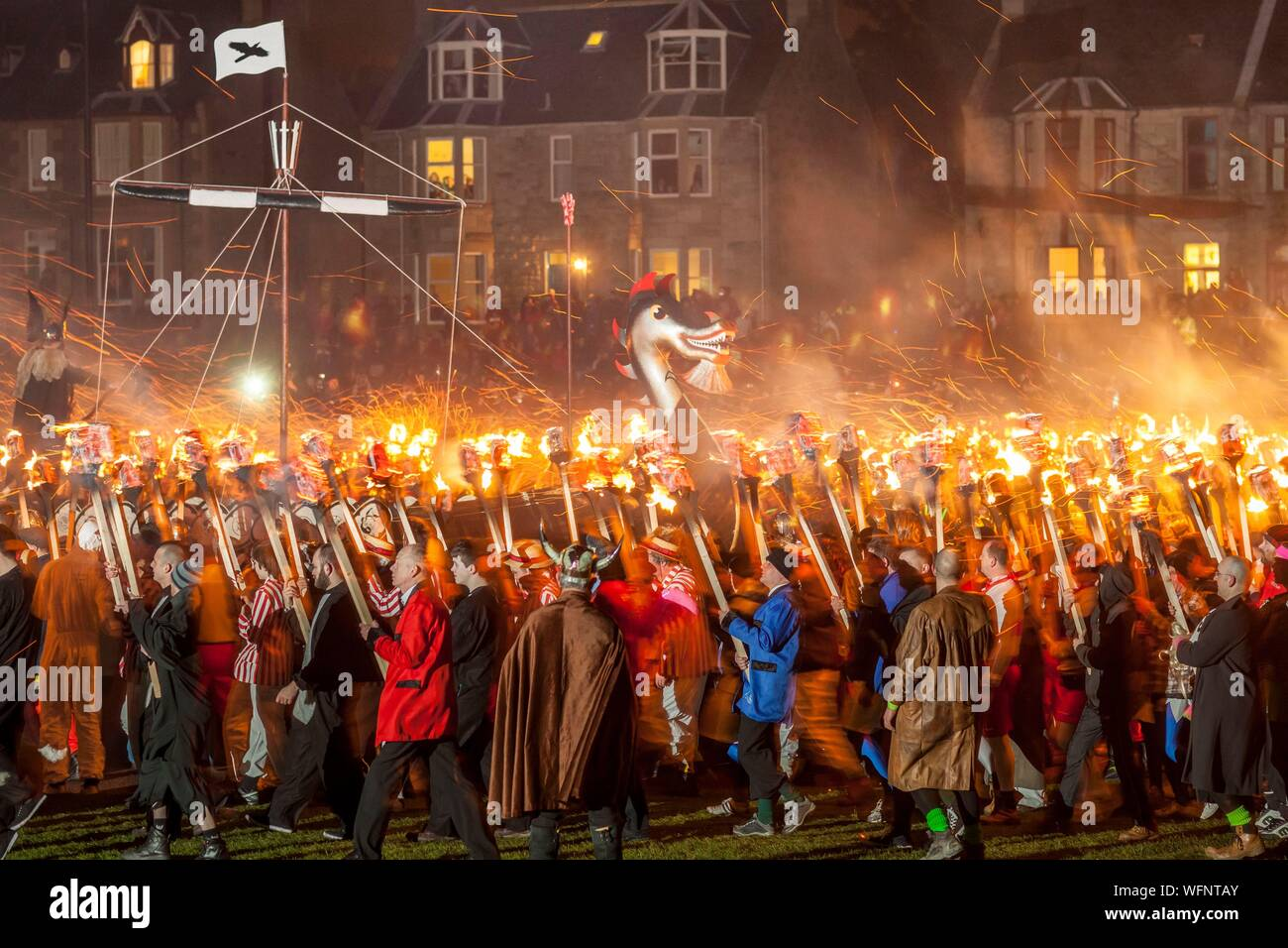 United Kingdom, Scotland, Shetland Islands, Mainland, Lerwick, Up Helly Aa festival, ritual burning down of the viking longship by throwing torches Stock Photo