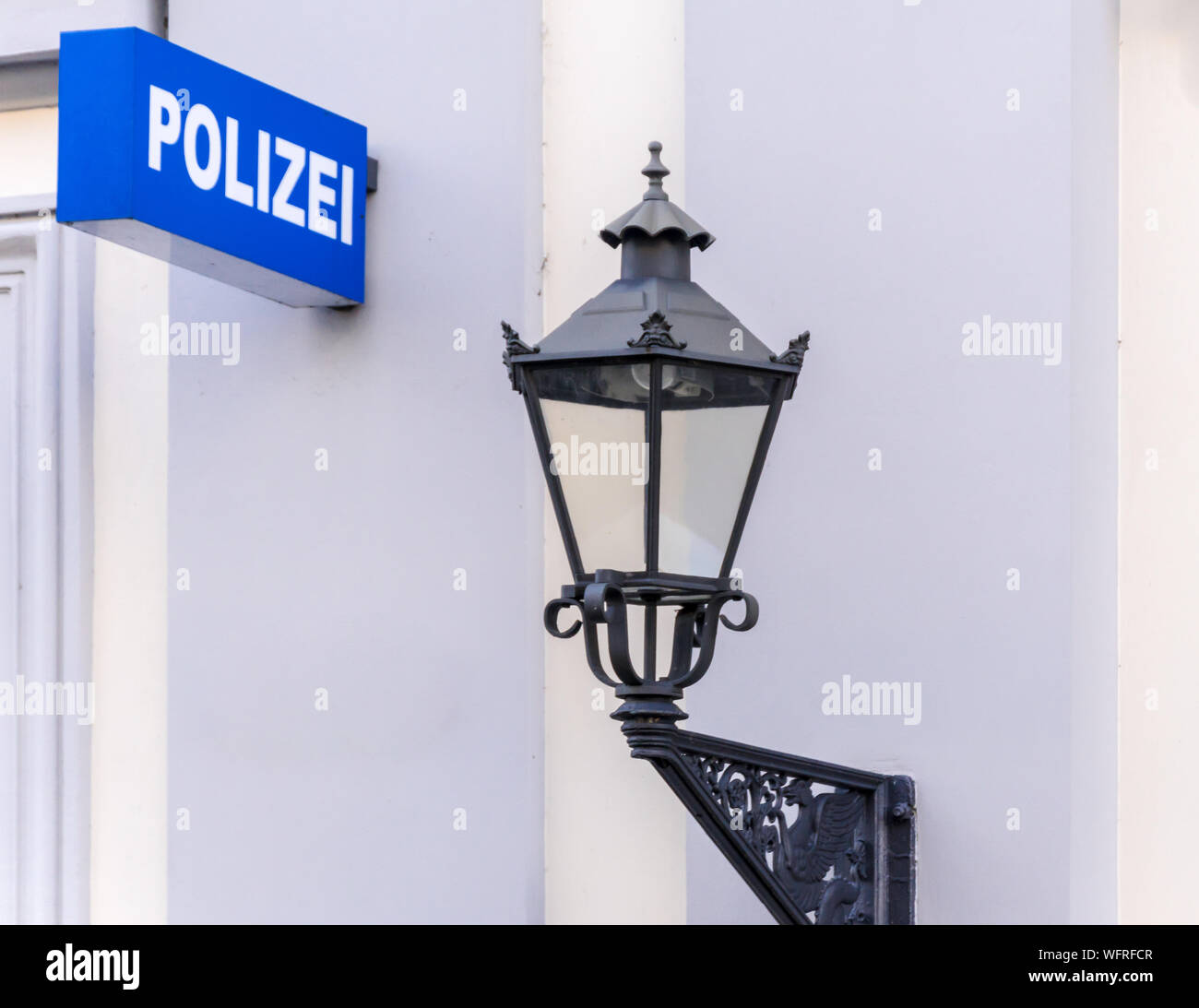 Low Angle View Of Police Sign And Lighting Equipment Stock Photo