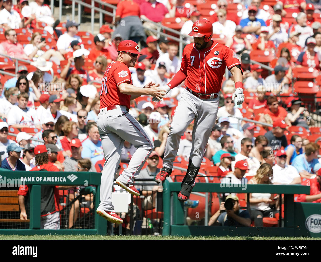 Cincinnati Reds Eugenio Suarez is greeted by third base