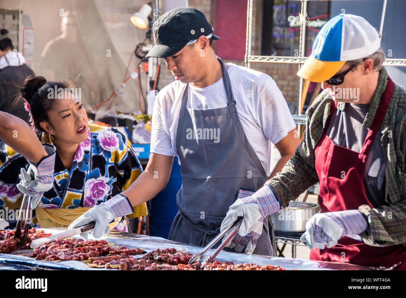 A group of volunteers cooking Korean food, at the Orange County International Food Fair. Stock Photo