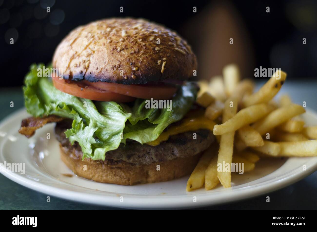 Close-up Of Burger With French Fries Served In Plate Stock Photo