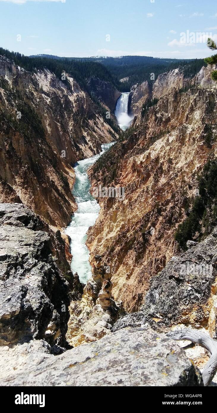 Scenic View Of Waterfall Against Sky Stock Photo