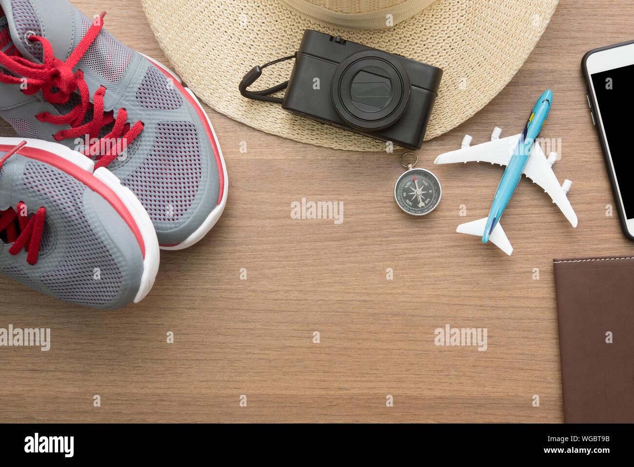 Travel Accessories On Wooden Desk Background With Passport