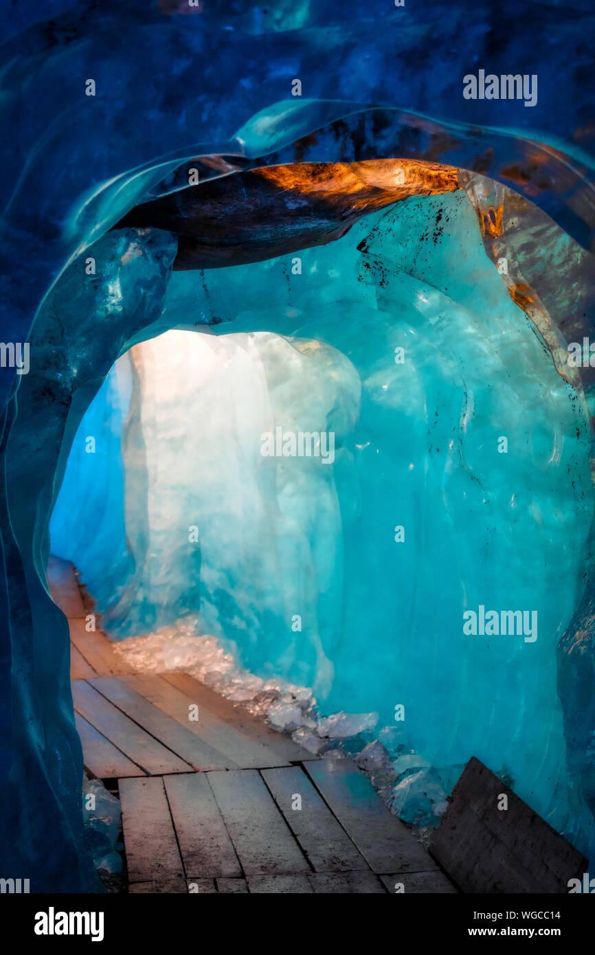 blue ice inside a cave under melting rhone glacier, switzerland Stock Photo