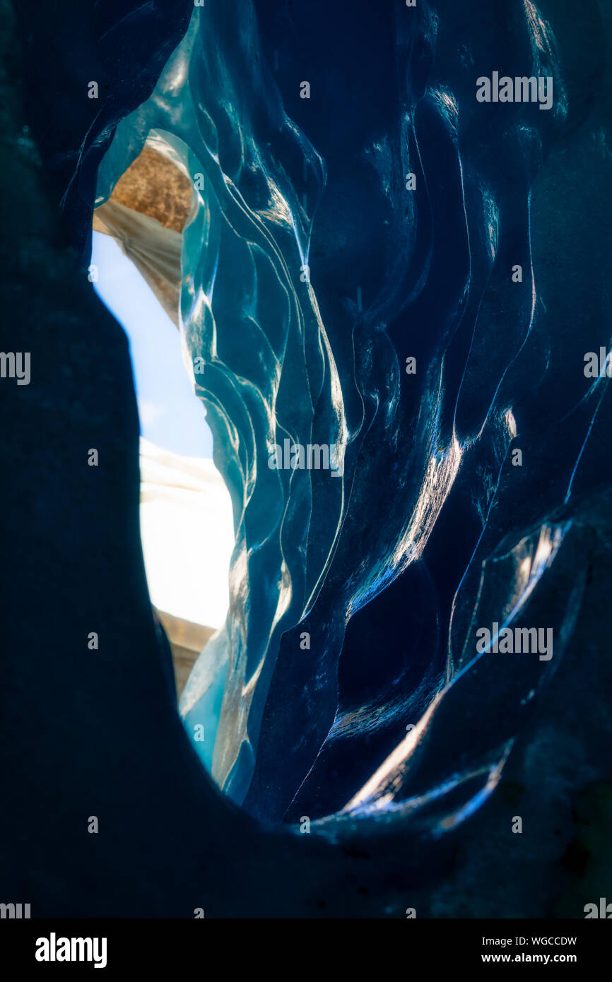 blue ice inside a cave under melting rhone glacier, switzerland Stock Photo