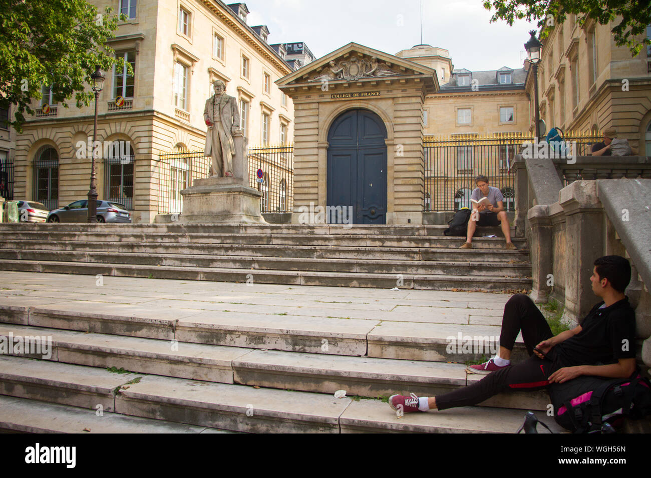 Paris, France - July 7, 2019: Claude Bernard statue in front of the main entrance to the College de France in Paris Stock Photo