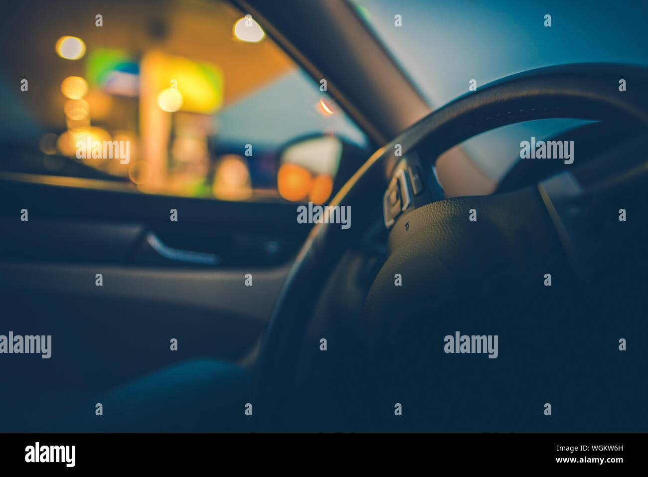 Close Up Of Car Steering Wheel At Night Stock Photo Alamy