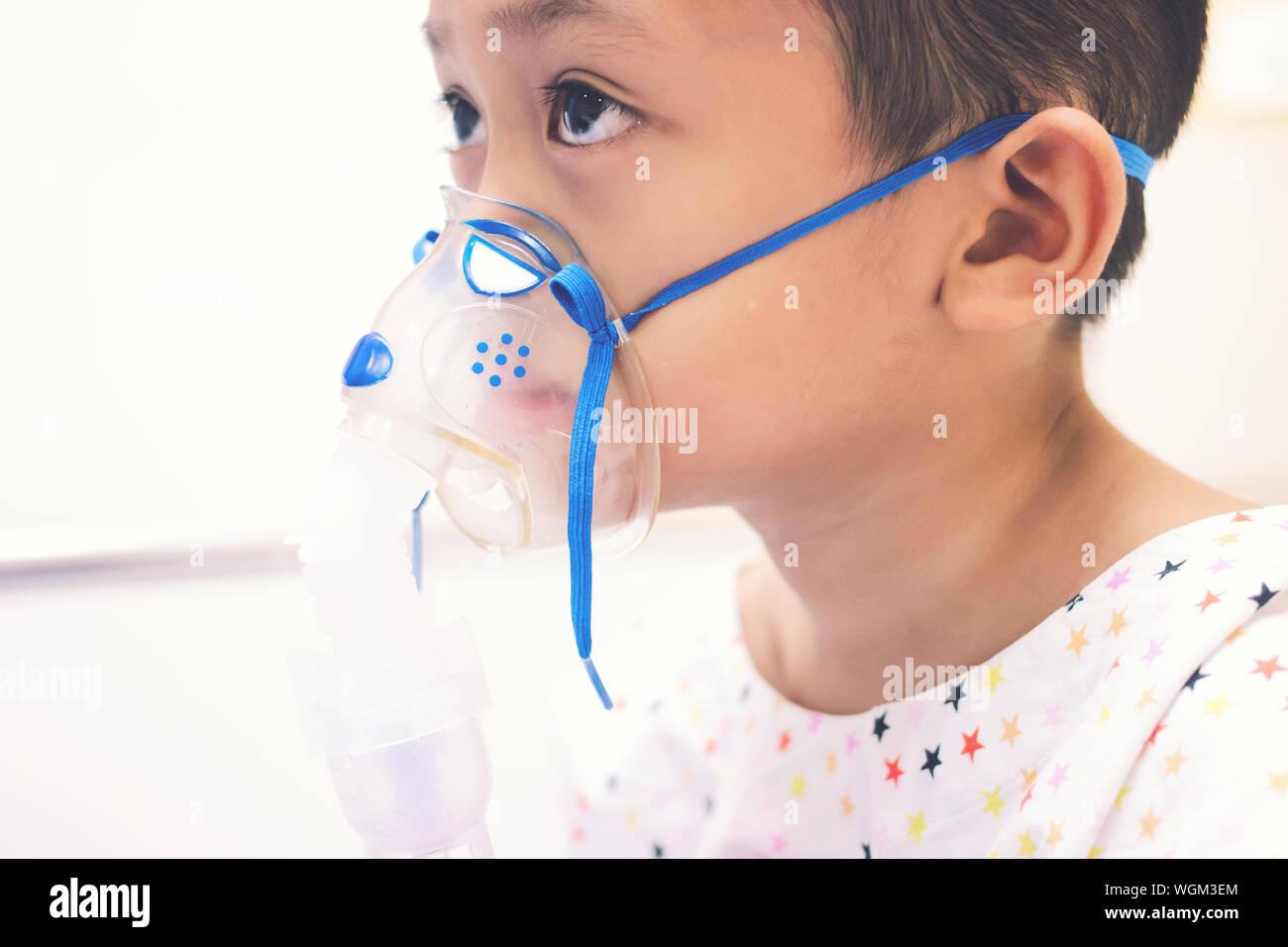 Close-up Of Boy Wearing Gas Mask Stock Photo