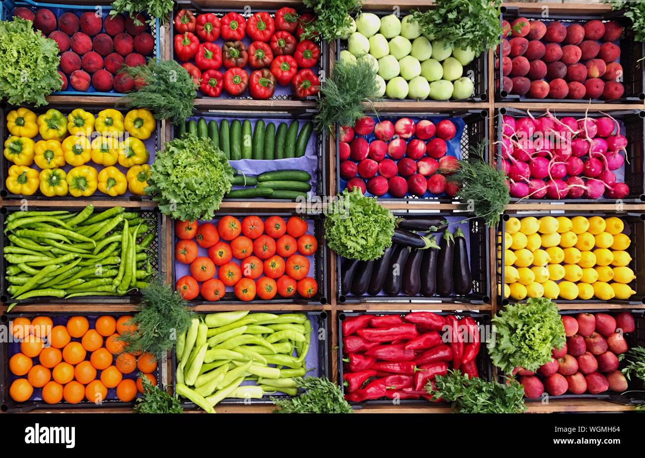 High Angle View Of Various Vegetables And Fruits For Sale At Market Stall Stock Photo