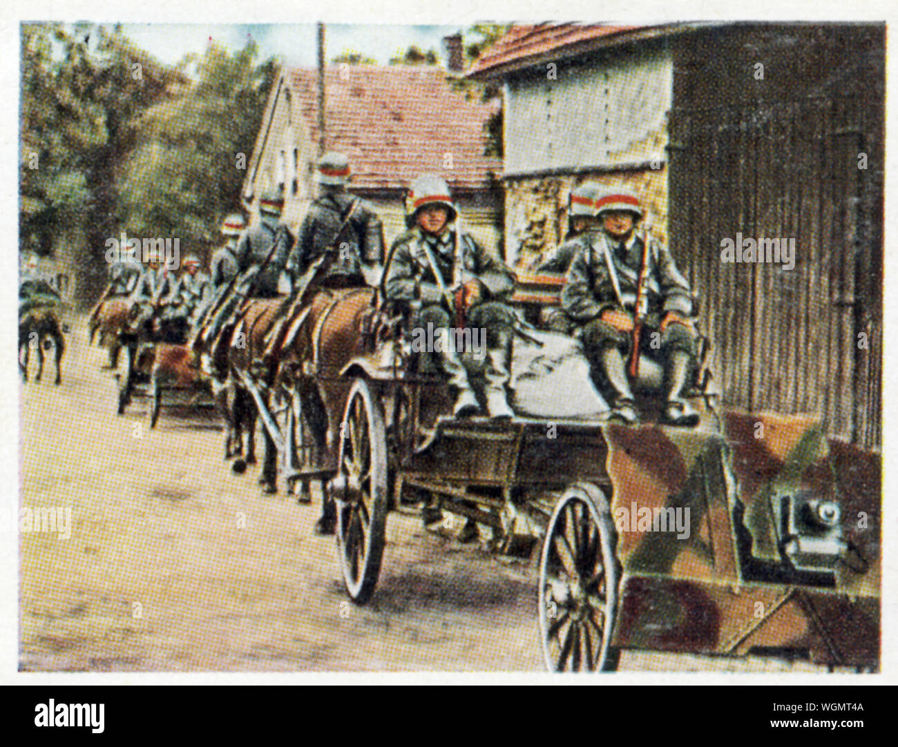 Wehrmacht Company of Light Guns, 1936 cigarette card of German soldiers training with a horse drawn detachment of 7.5 cm infabtry support guns and mortars Stock Photo