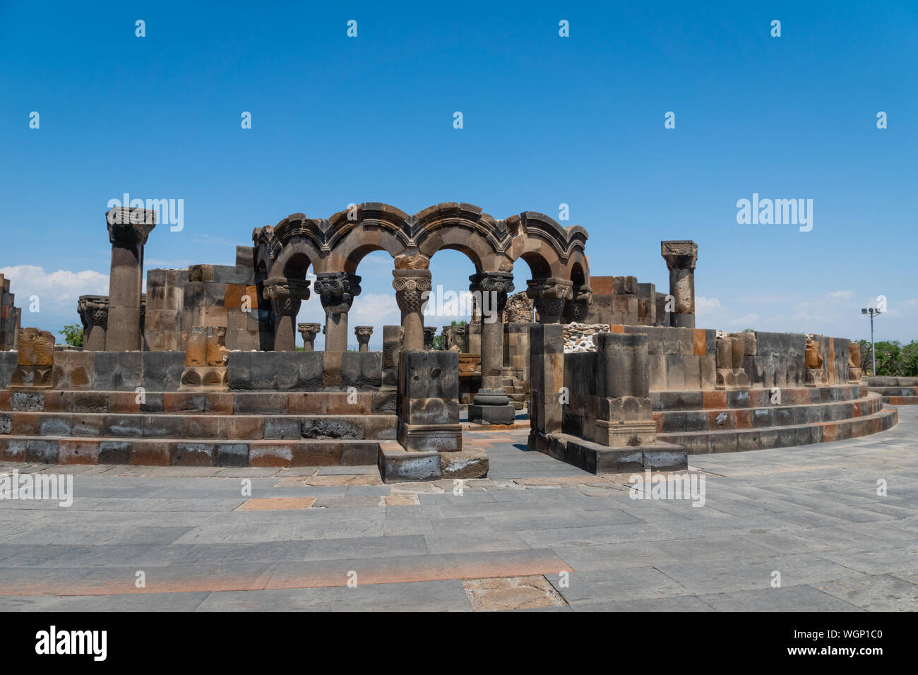 Zvartnots Cathedral ruin near Yerevan, Armenia. Zvartnots Cathedral is a 7th-century centrally planned aisled tetraconch type Armenian cathedral Stock Photo