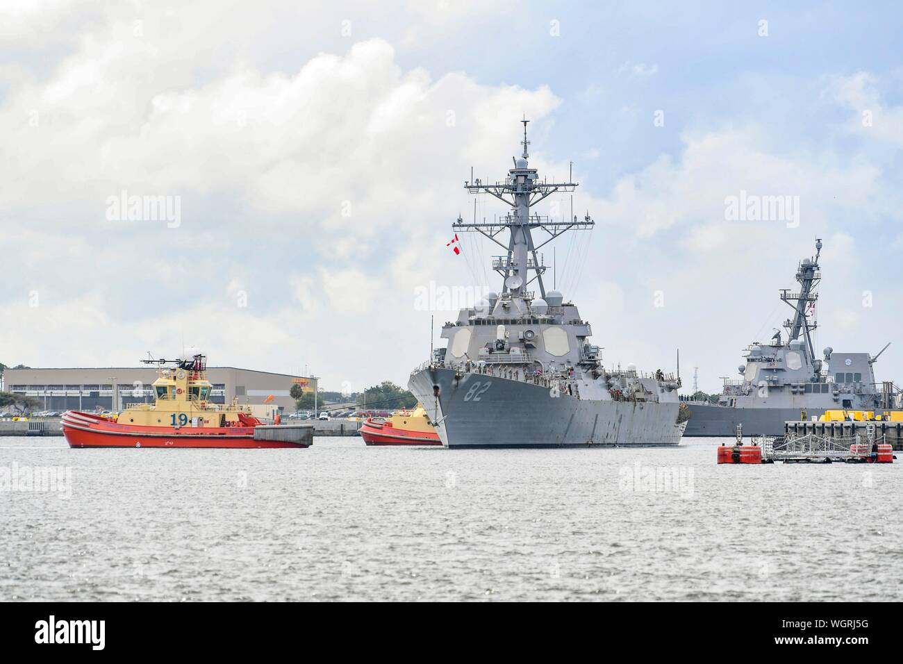 190830-N-DA434-100  JACKSONVILLE, Fla. (Aug. 30, 2019) The Arleigh Burke-class guided-missile destroyer USS Lassen (DDG 82) gets underway from Naval Station Mayport as Commander, U.S. 4th Fleet orders all U.S. Navy ships homeported in the area to sortie ahead of Hurricane Dorian, which is forecasted to bring high winds and heavy rain to the East Coast. Ships are being directed to areas in the Atlantic where they are best postured for storm avoidance. (U.S. Navy photo by Mass Communication Specialist 3rd Class Alana Langdon/Released) Stock Photo