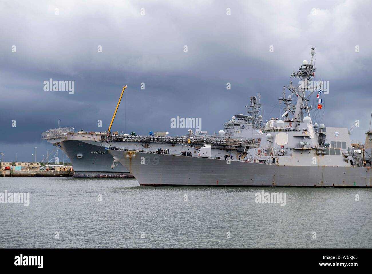 190830-N-QI061-4265  JACKSONVILLE, Fla. (Aug. 30, 2019) The Arleigh Burke-class guided-missile destroyer USS Farragut (DDG 99) departs from Naval Station Mayport as Commander, U.S. 4th Fleet orders all U.S. Navy ships homeported in the area to sortie ahead of Hurricane Dorian, which is forecasted to bring high winds and heavy rain to the East Coast. Ships are being directed to areas in the Atlantic where they are best postured for storm avoidance. (U.S. Navy photo by Mass Communication Specialist 3rd Class Nathan T. Beard/Released) Stock Photo