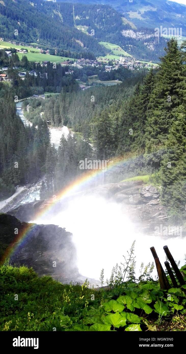Scenic View Of Rainbow Over Krimml Waterfalls Stock Photo
