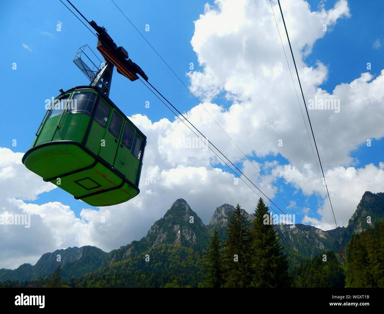 Low Angle View Of Ski Lift By Mountains Against Sky Stock Photo
