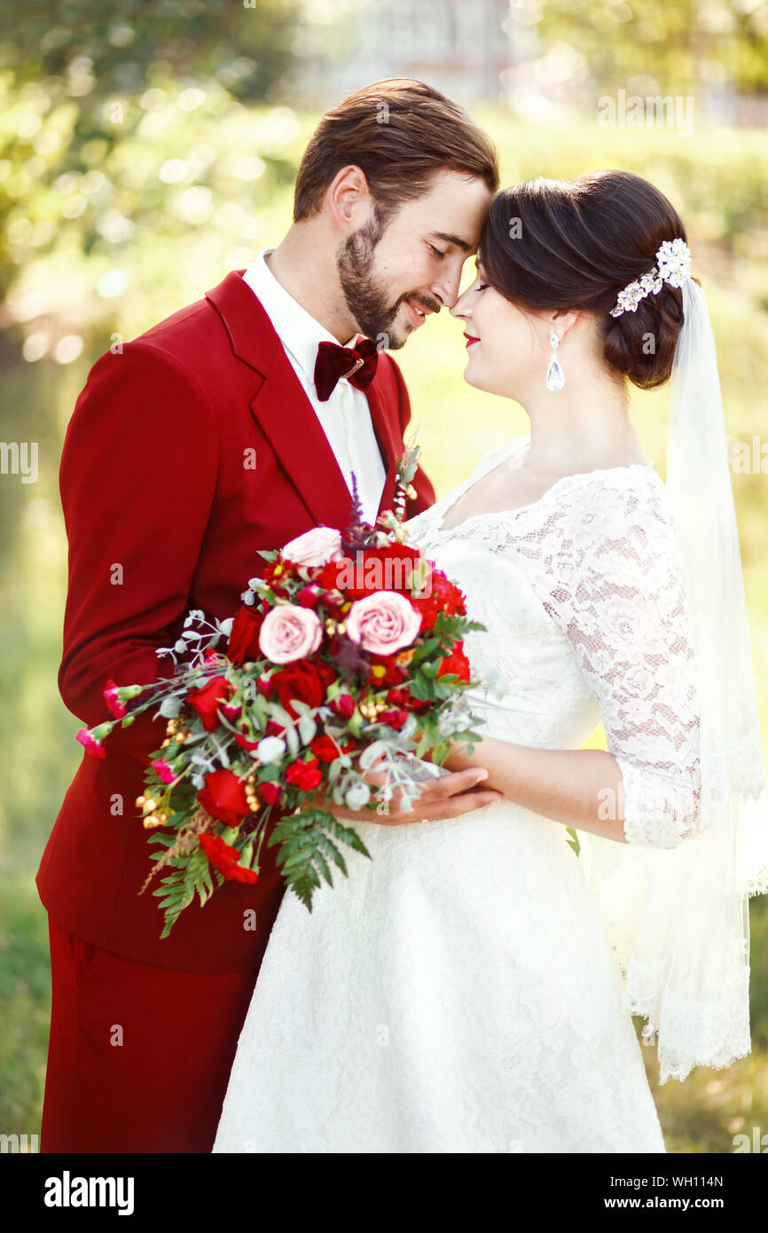 Newly Wed Couple Embracing In Marriage Ceremony Stock Photo
