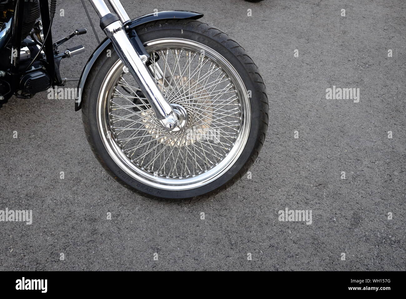 Close-up Of Motorcycle Wheel Outdoors Stock Photo