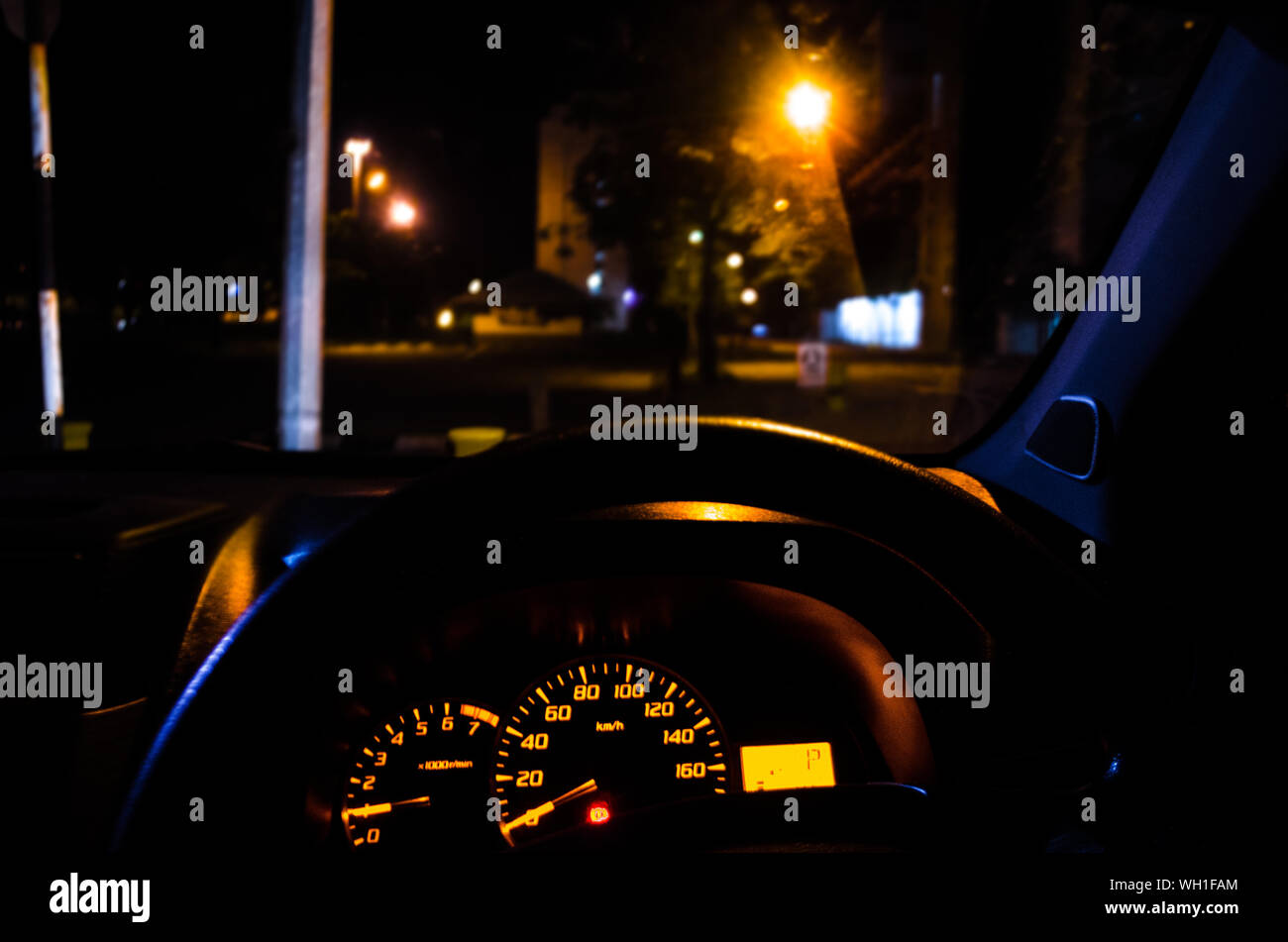 Close Up Of Illuminated Speedometer And Steering Wheel In Car At Night Stock Photo Alamy