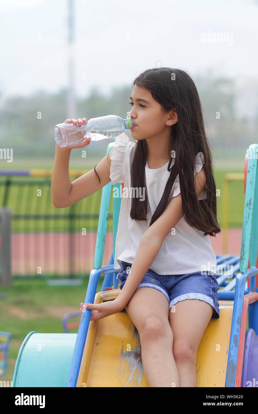 Asian Girls Drink Bottled Water Stock Photo Alamy