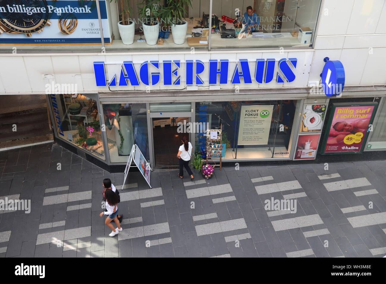 STOCKHOLM, SWEDEN - AUGUST 23, 2018: People walk by Lagerhaus in Drottninggatan street, Stockholm. Drottninggatan is one of most recognizable shopping Stock Photo