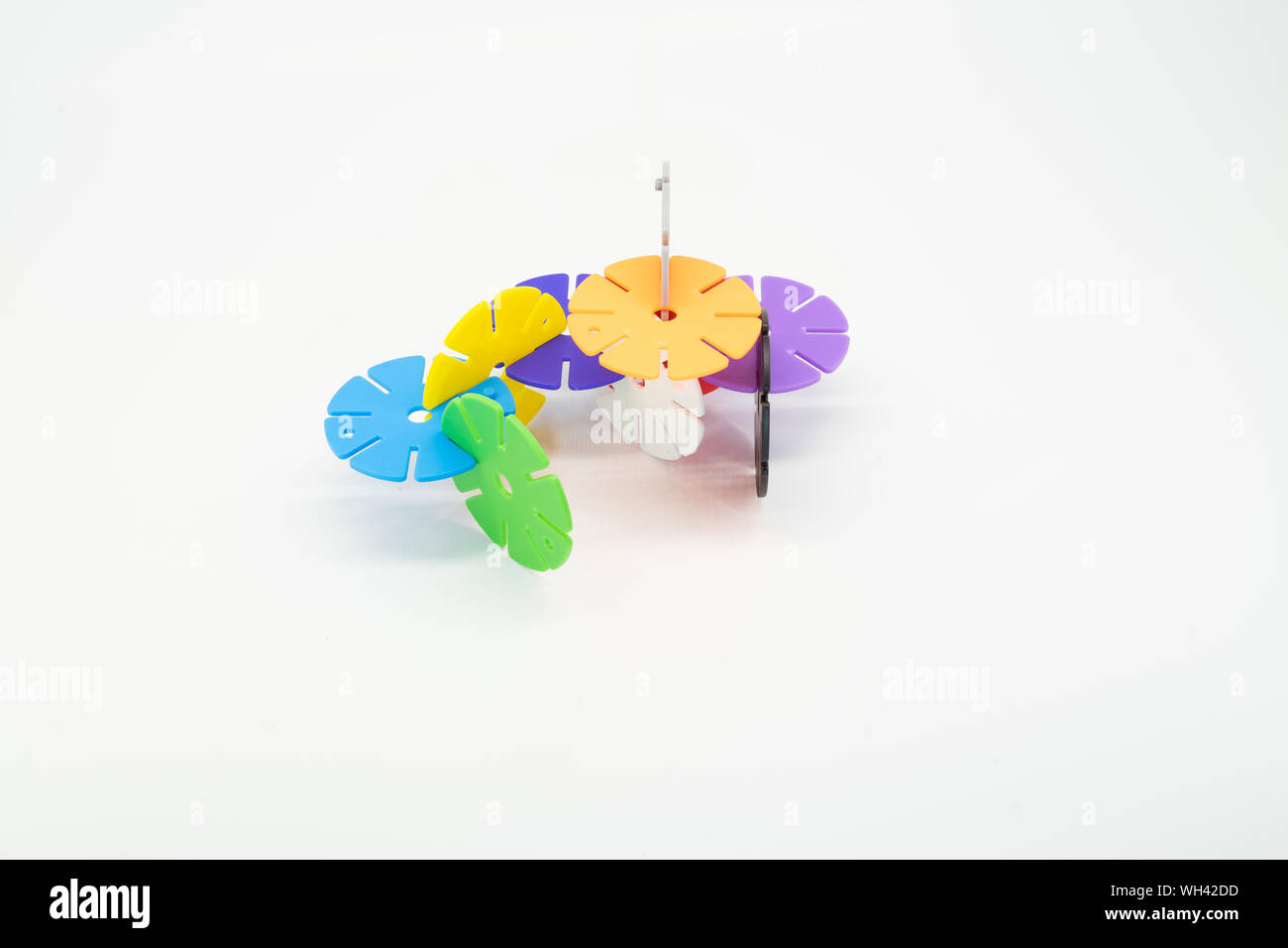 Colourful pieces of round puzzle. Concept of process completion. Copy space. Stock Photo