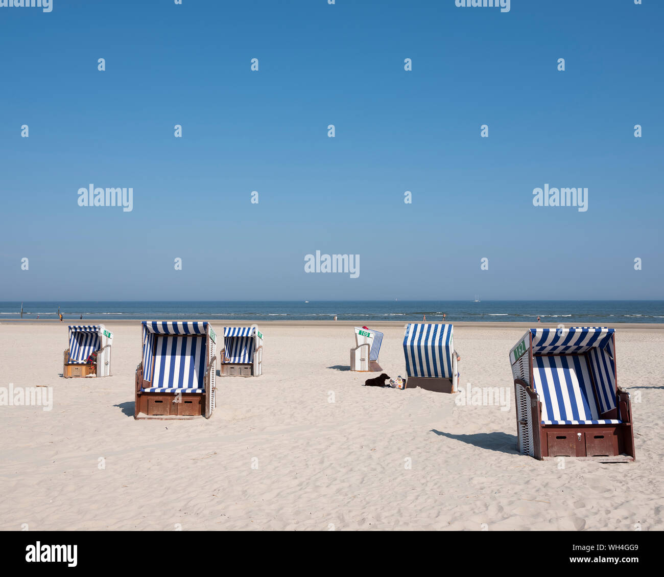 beach korbs on the island of norderney in germany on sunny day Stock Photo