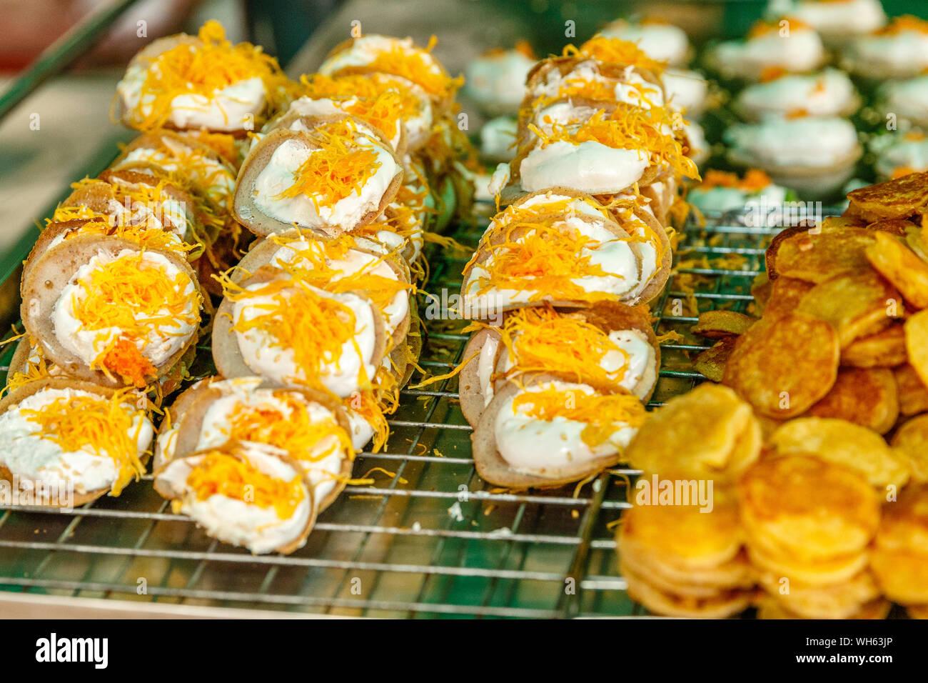 Khanom Buang - Thai traditional dessert, crispy pancake made with cream and Foi Thong (egg golden threads) on top. Thai street food. Bangkok, Thailand. Stock Photo