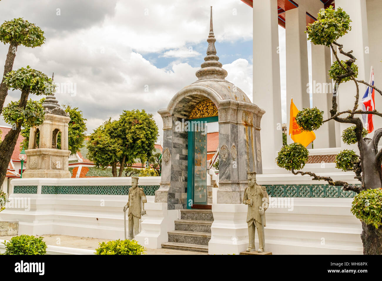 Statues at the entrance of Wat Suthat Thepwararam, old royal Buddhist temple (wat) in Bangkok, Thailand. Stock Photo