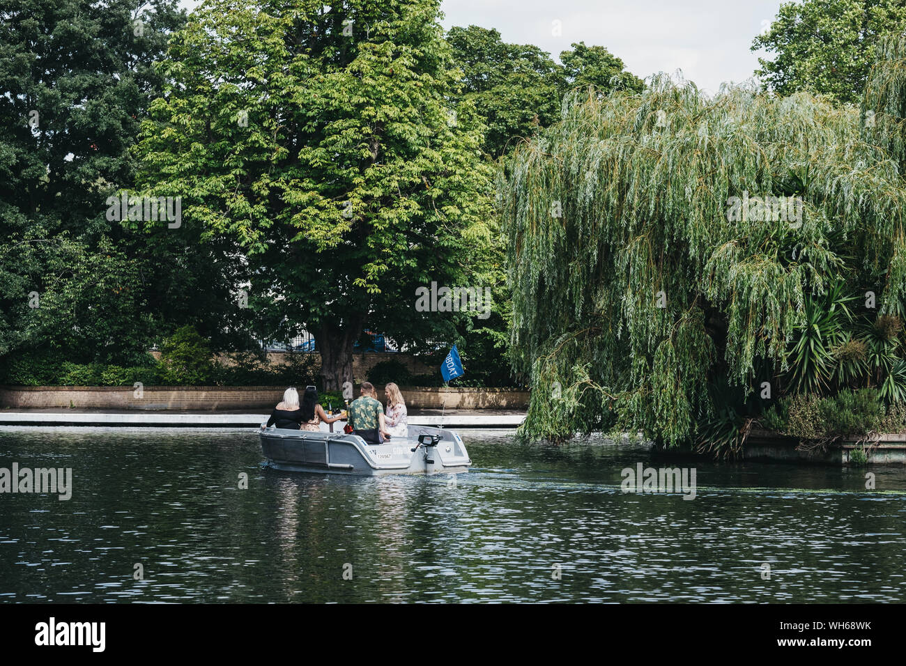 London, UK - July 18, 2019: People having a picnic on a boat on Regents Canal in Little Venice, London, a tranquil area of the city where the Grand Un Stock Photo