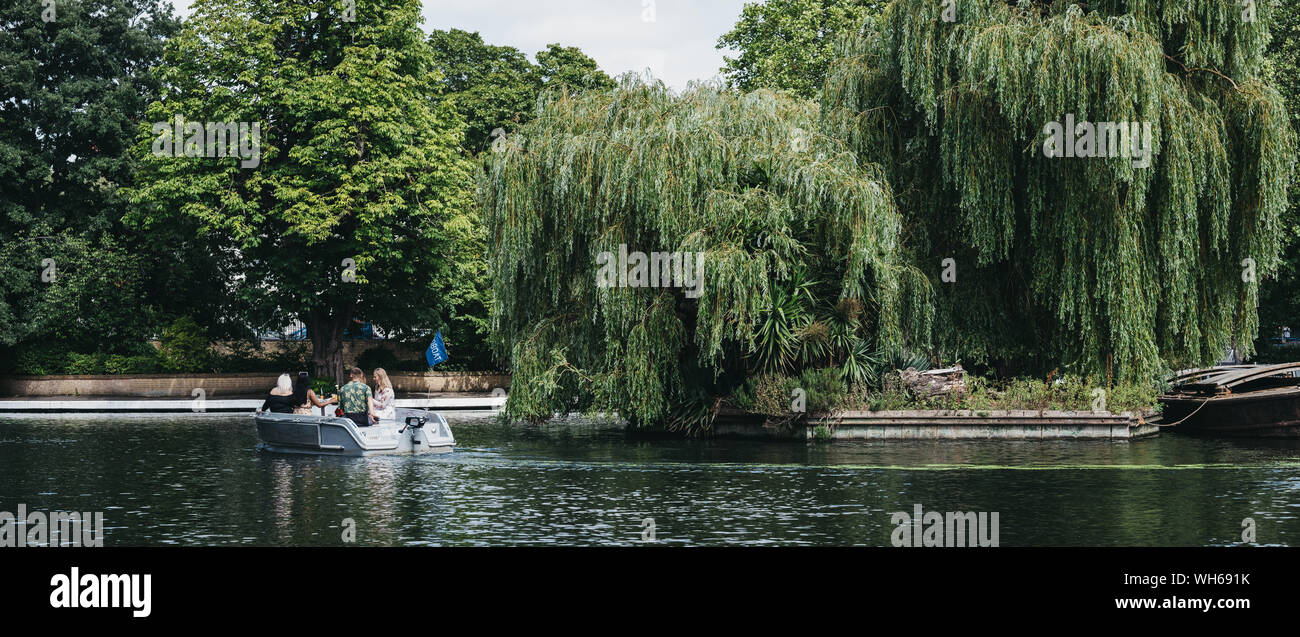 London, UK - July 18, 2019: Panoramic view of people having a picnic on a boat on Regents Canal in Little Venice, London, a tranquil area of the city Stock Photo