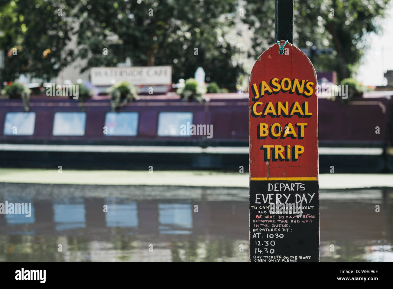 London, UK - July 18, 2019: Jasons Canal Boat Trip sign on Regents Canal in Little Venice, London, a tranquil area of the city where the Grand Union a Stock Photo