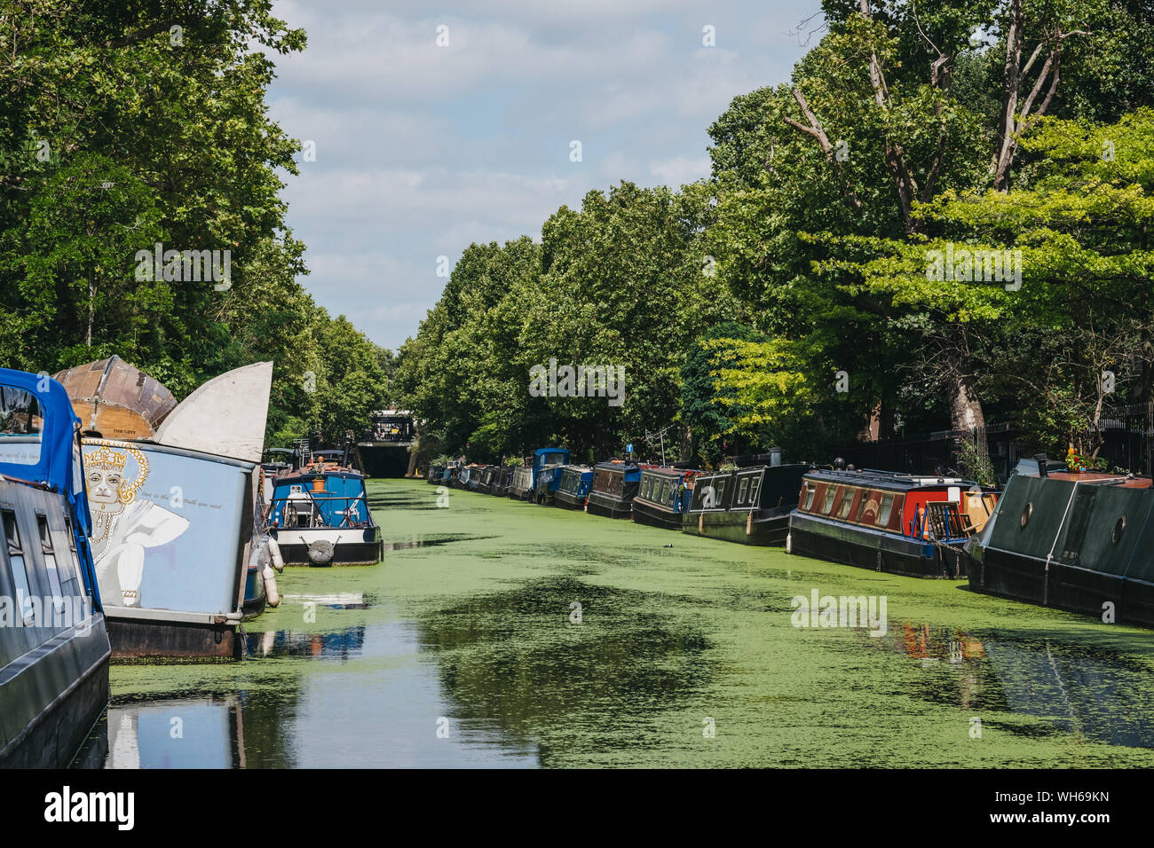 London, UK - July 18, 2019: View of the houseboats moored on both sides of Regents Canal in Little Venice, London, a tranquil area of the city where t Stock Photo