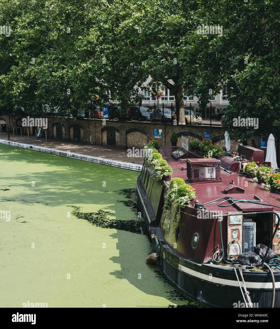 London, UK - July 18, 2019: View of Waterside boat cafe moored on Regents Canal in Little Venice, London, a tranquil area of the city where the Grand Stock Photo