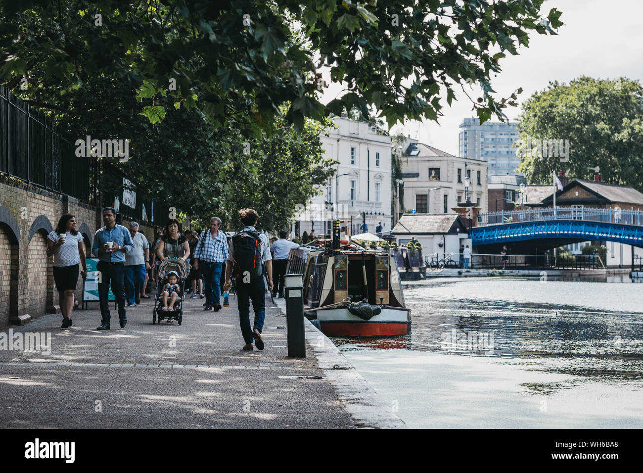 London, UK - July 18, 2019: People walking past boats on Regents Canal in Little Venice, London, a tranquil area of the city where the Grand Union and Stock Photo