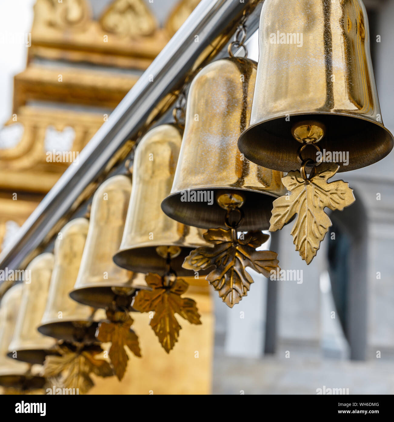 Golden bells at Buddhist temple Wat Traimit, Bangkok, Thailand. Square image. Stock Photo