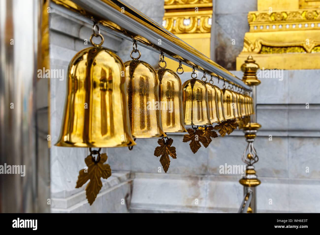 Golden bells at Buddhist temple Wat Traimit, Bangkok, Thailand. Stock Photo
