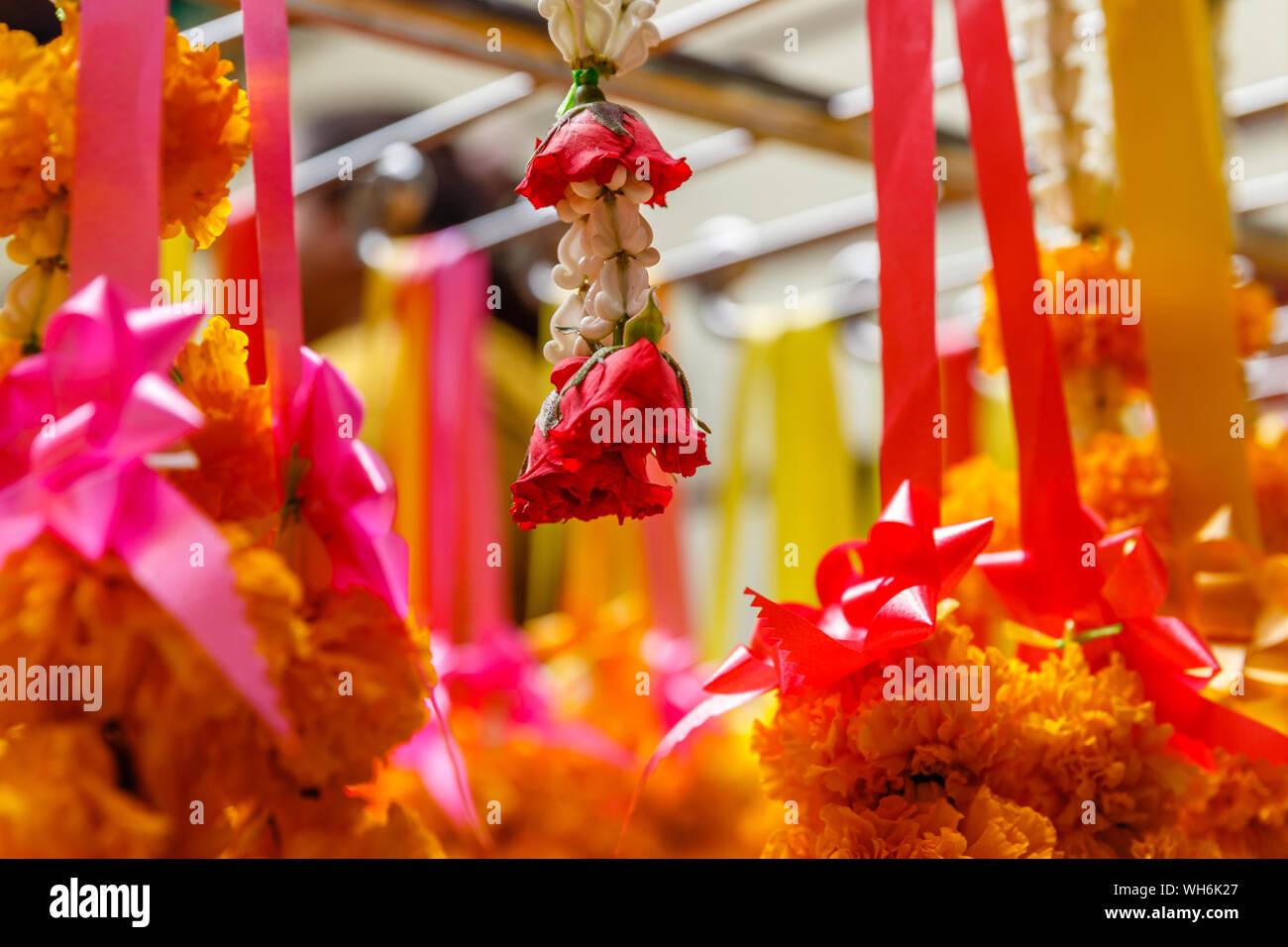 Phuang malai, traditional Thai flower offerings at Wat Mangkon Kamalawat or Wat Leng Noei Yi, largest Chinese Buddhist temple in Bangkok, Thailand Stock Photo