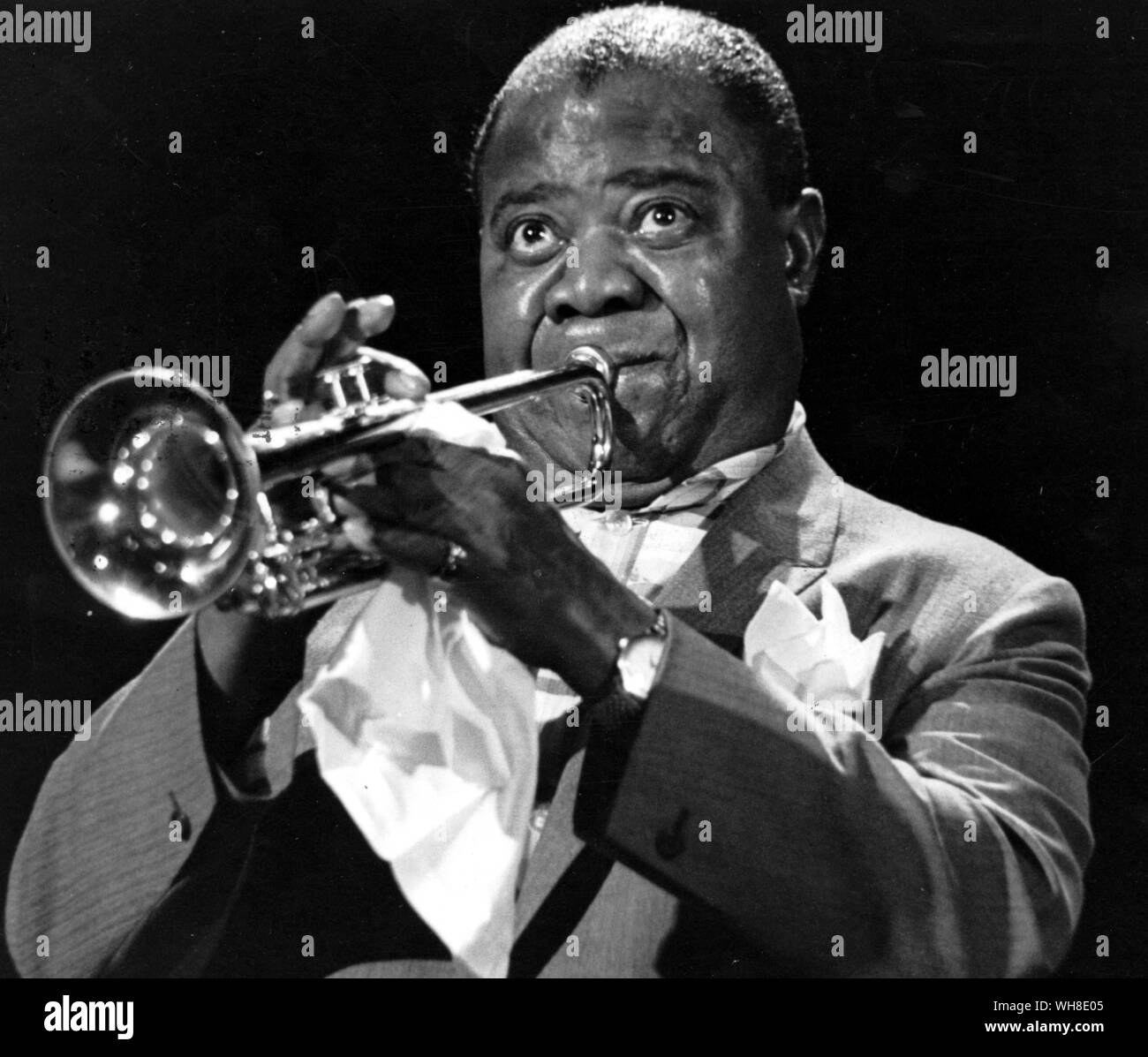 Louis Satchmo Armstrong (1901-1971) playing the trumpet in 1965.. . Stock Photo