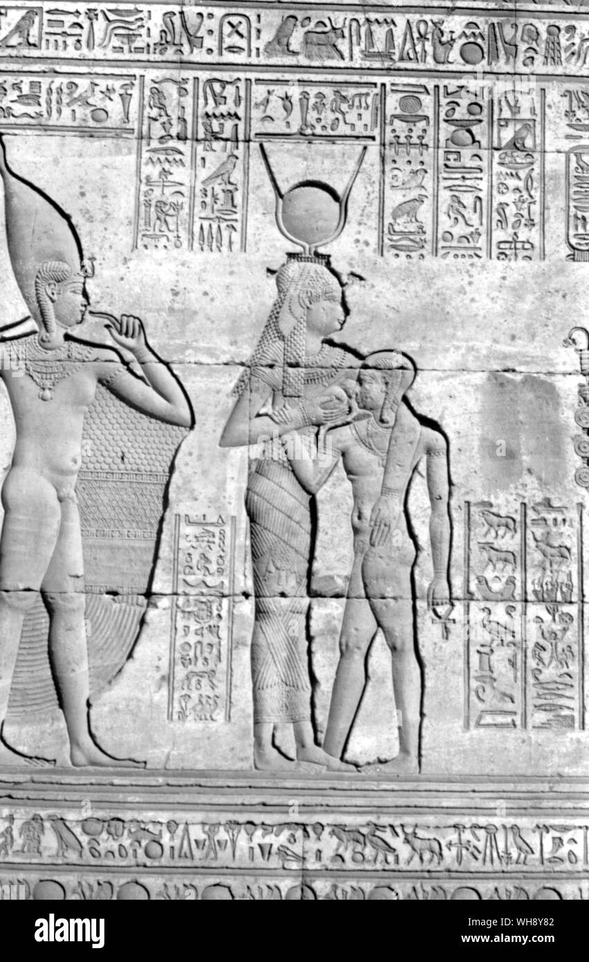 Sandstone relief of the goddess Hathor suckling the infant god from the mammisi at Denderah, built in the time of Augustus and decorated subsequently.. Stock Photo